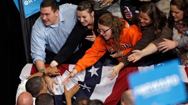 Students reach out to President Barack Obama at a campaign event at Bowling Green State University.
