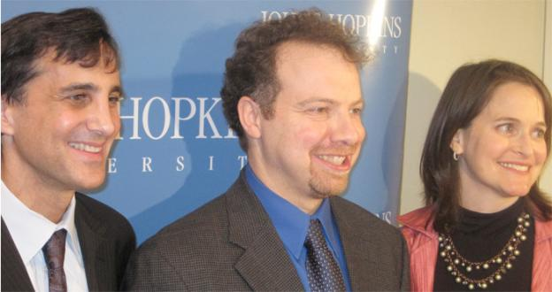 Nobel Prize recipient Adam Riess, center, flanked by his wife Nancy and President of Johns Hopkins University, Ronald Daniels at Tuesday's press conference in Baltimore.