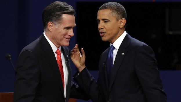 Republican presidential nominee Mitt Romney and President Barack Obama talks after the first presidential debate at the University of Denver, Wednesday, Oct. 3, 2012, in Denver.