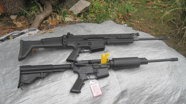 The gun at the top is an AR-10, which is legal. On the bottom is an AR-15, which is not. For further clarification, this particular AR-10 in the photo is banned because it has a folding stock. If it had a sliding stock, like the AR-15 in the picture, it would be legal.