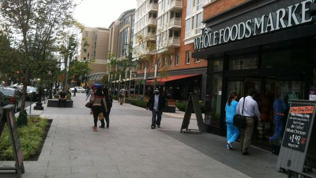 Pedestrians outside the new Whole Foods near the Foggy Bottom/GWU Metro station.