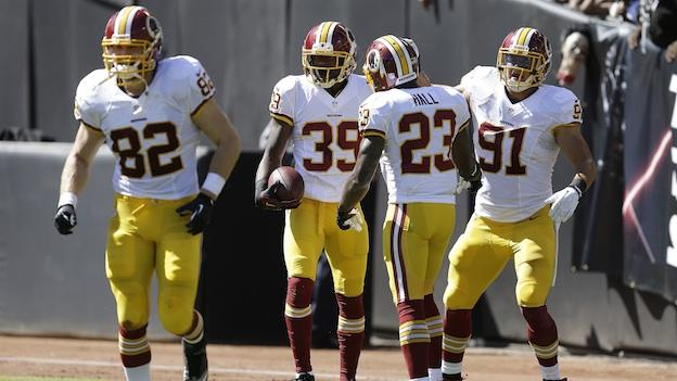 Washington Redskins free safety David Amerson (39) celebrates with cornerback DeAngelo Hall (23), outside linebacker Ryan Kerrigan (91) and tight end Logan Paulsen (82) after returning an interception from Oakland Raiders quarterback Matt Flynn for a 45-yard touchdown during the second quarter of an NFL football game in Oakland, Calif., Sunday, Sept. 29, 2013.