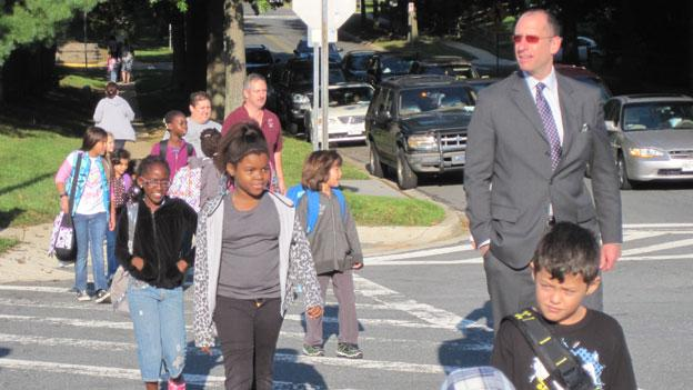 Montgomery County schools superintendent Dr. Joshua Starr walks with students to class at Captain James Daly Elementary in Germantown.