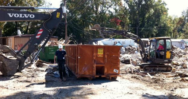 Workers clean up a trailer park in Woodbridge, Va. that was destroyed in the flooding from Tropical Storm Lee in September.