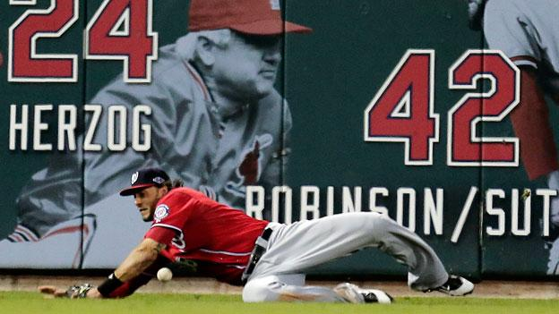 Washington Nationals left fielder Michael Morse tries to catch a double hit by St. Louis Cardinals' Pete Kozma during the eighth inning of Game 2 of the National League division baseball series, Monday, Oct. 8 in St. Louis.