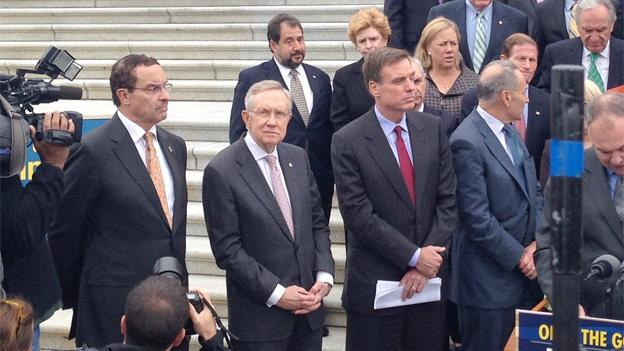 Mayor Vincent Gray, left, sidled up to Senate Majority Leader Harry Reid after crashing the press conference.