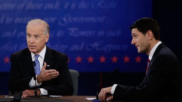Vice President Joe Biden, left, and Republican vice presidential nominee Paul Ryan, of Wisconsin, speak during the vice presidential debate at Centre College, Thursday, Oct. 11, 2012, in Danville, Ky.