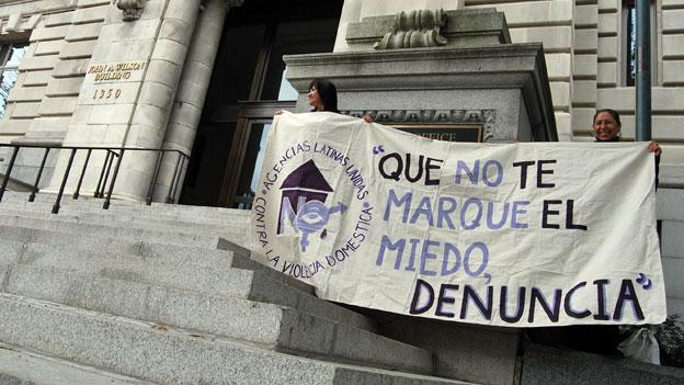 Latino advocates raise awareness outside the Wilson Building Oct. 10.