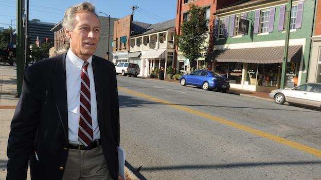In this Thursday, Sept. 13, 2012 photo, presidential candidate Virgil Goode Jr. works the campaign trail in downtown Lynchburg, Va.
