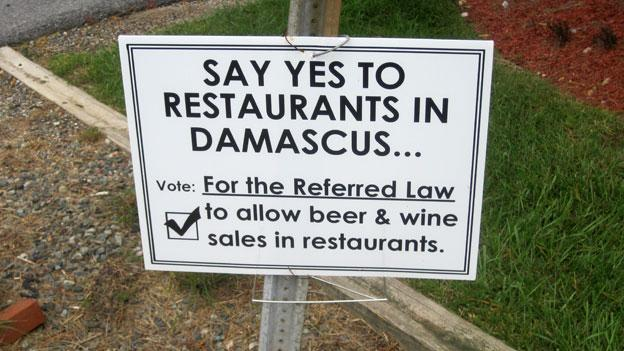 A sign in the yard of a supporter of repealing Damascus' alcohol sales prohibition.