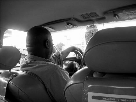 A D.C. cab gives someone a ride. Many of D.C.'s immigrant cab drivers left behind professional careers in their home countries.