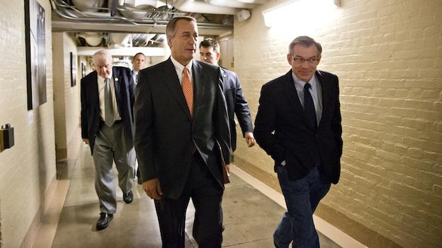 Speaker of the House John Boehner, R-Ohio, walks with Rep. David Schweikert, R-Ariz., right, and fellow Republicans for an early closed-door meeting in the basement of the Capitol in Washington, Saturday, Oct. 12, 2013. The federal government remains partially shut down and faces a first-ever default between Oct. 17 and the end of the month.