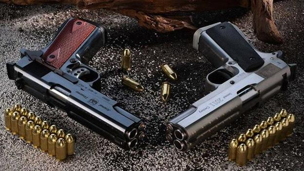 Photo shows double barrel semi-automatic pistols.