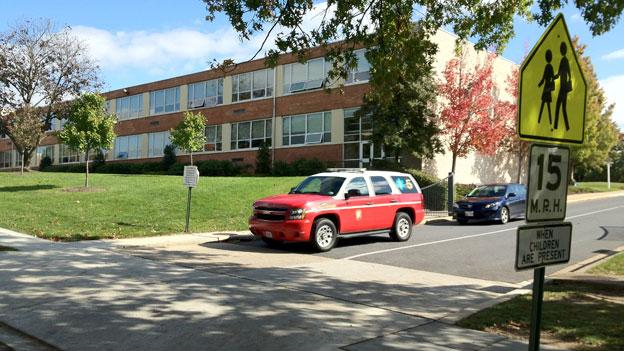 A last emergency vehicle prepares to leave St. John's College High School in Northwest D.C. October 16.
