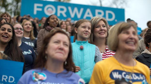 Supporters look on as President Barack Obama speaks about the choice facing women in the upcoming election, Friday, Oct. 19, 2012, at a campaign event at George Mason University in Fairfax, Va.