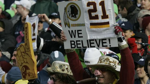 A Washington Redskins fan holds a sign remembering Washington Redskins safety Sean Taylor, who was killed during a robbery of his home, prior to the start of an NFL football wildcard playoff game between the Seattle Seahawks and the Redskins, Saturday, Jan. 5, 2008, at Qwest Field in Seattle.