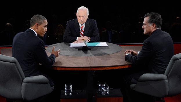 President Barack Obama speaks as Republican presidential nominee Mitt Romney and moderator Bob Schieffer listen during the third presidential debate at Lynn University, Monday, Oct. 22, 2012, in Boca Raton, Fla.