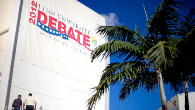 Workers enter the debate hall ahead of Monday's presidential debate between Republican presidential candidate and former Massachusetts Gov. Mitt Romney and President Barack Obama at Lynn University in Boca Raton, Fla.