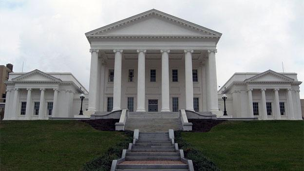 The deadlocked Virginia state Senate voted 20-19 to redraw Senate districts with Sen. Henry Marsh absent, attenting the inauguration.