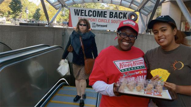 Workers from the local Krispy Kreme were handing out donut samples and the newly-reopened south entrance to Dupont Circle.