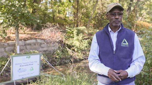 Dennis Chestnut stands next to a stretch of the Anacostia River in Washington, D.C., on Oct. 2. Chestnut, who has been working to clean up the Anacostia for decades, says it can take a long time for a nonprofit to see an end result.