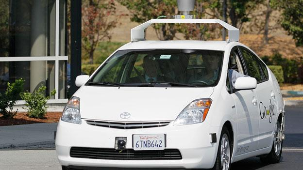 California Gov. Edmund G. Brown Jr., front left, rides in a driverless car  to a bill signing at Google headquarters in Mountain View, Calif., Tuesday, Sept. 25, 2012.