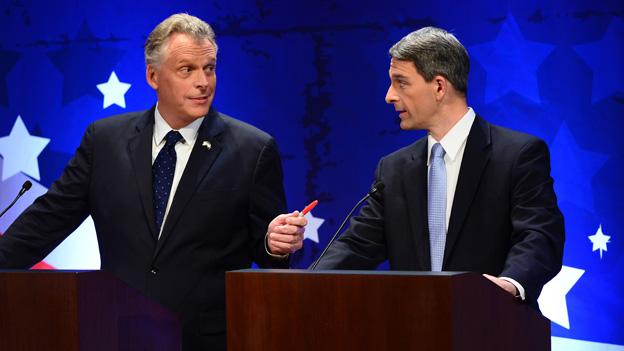 Virginia gubernatorial candidates Democrat Terry McAuliffe, left, and Republican Attorney General Ken Cuccinelli talk before a Fairfax County Chamber of Commerce debate Wednesday, Sept. 25, 2013, in McLean, Va.