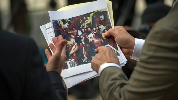 Maryland Attorney General, and candidate for governor, Doug Gansler, left, reacts to Jim Avila, senior national correspondent at ABC News, as he shows him a photograph while meeting with reporters to explain his actions during a summertime visit to a teenage house party.
