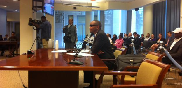Sulaimon Brown testifies before a D.C. Council committee in June. Brown, who has accused the campaign of now-Mayor Vincent Gray of a quid pro quo scheme, will go to trial for a traffic charge.
