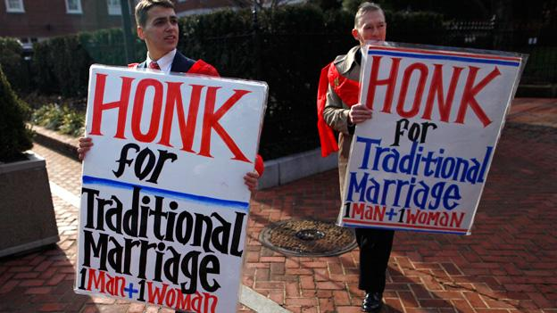 In this Feb. 17, 2012 file photo, Zachariah Long, left, and Edward Ritchie protest against a gay marriage bill in Annapolis, Md.