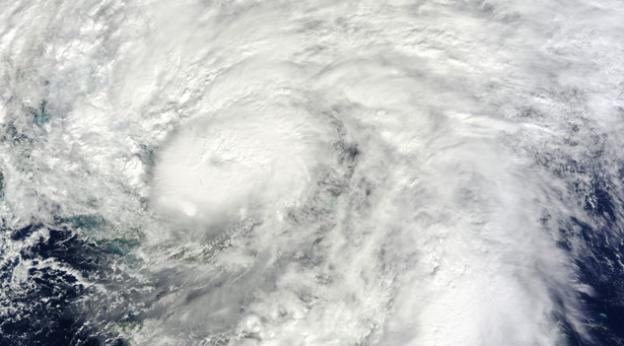 Hurricane Sandy is moving through the Bahamas and the view from a NASA satellite shows clouds spreading over South Florida.