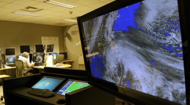 A satellite image of Hurricane Sandy is shown on a computer screen at the National Hurricane Center in Miami on Friday, Oct. 26, 2012. Sandy left 21 people dead as it moved through the Caribbean, following a path that could see it blend with a winter storm and reach the U.S. East Coast as a super-storm next week.