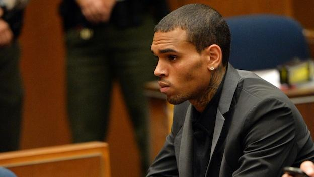 R&B singer Chris Brown, left, with his Attorney Mark Geragos appear during a court hearing at Los Angeles Superior court in Los Angeles Monday, July 15, 2013. The singer has been on felony probation in the 2009 beating of former girlfriend Rihanna.