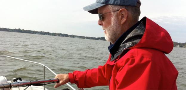 Chesapeake Bay Foundation senior naturalist John Page Williams watches the waters for menhaden. The foundation would like to see the threshold for overfishing menhaden lifted from 8 to 15 percent, and the stock built back to 30-40 percent of what it would be with no menhaden fishing at all.