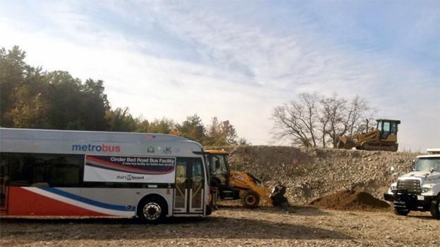 A Metrobus idles near the future site of a garage in Lorton, Va.