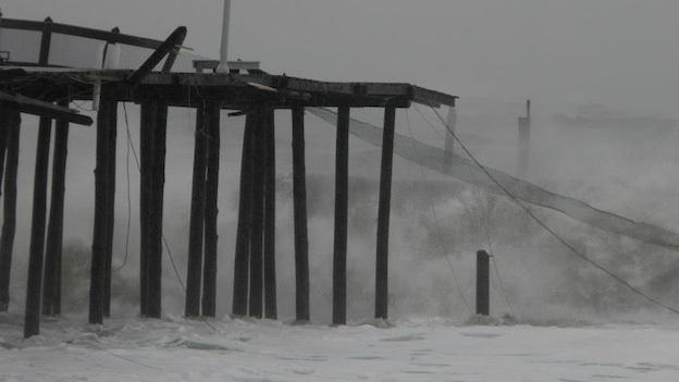 Then-Hurricane Sandy's surging waves destroyed a portion of Ocean City's landmark pier.
