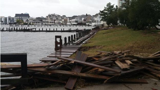 A torn-up dock in Ocean City, Md. is just one of many bits of local infrastructure which will have to be repaired.