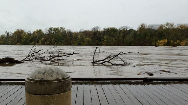 The Potomac River came within inches of overflowing a wooden riverfront walkway  during high tide Tuesday, Oct. 30.