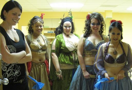 Belladonna Wynkoop, left, watches a rehearsal video with members of the dance troupe Bellatrix.