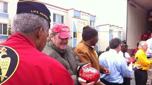 Winthrop Robbins (in the red hat) received a ham from Smithfield.