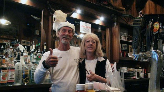 John Clark, known as Curly, with another Tune Inn employee behind the bar.