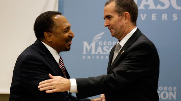 Candidates for Virginia Lt. Governor, Republican E.W. Jackson, left, and Democrat Ralph S. Northam shake hands after a debate at George Mason University, Tuesday, Sept. 24, 2013 in Arlington, Va.