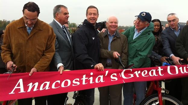 D.C. Mayor Vincent Gray, left, cuts the ribbon on a segment of the Anacostia Riverwalk trail in November.