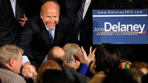 John Delaney, Democratic challenger for the Maryland's 6th Congressional District, shakes hands of supporters at an election night event, Tuesday, Nov. 6, 2012, in Potomac, Md.