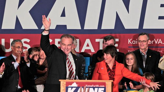 Democratic senate candidate former Gov. Timothy Kaine, and his wife Anne Holton, right, celebrates his win over Republican George Allen during his victory party in Richmond, Va., Wednesday