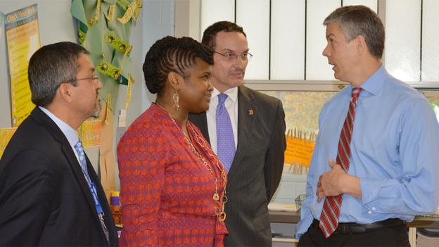 Acting State Superintendent of Education Jesus Aguirre, educator Shantelle Wright, Mayor Vincent Gray and U.S. Secretary of Education Arne Duncan talk before the press conference Thursday.