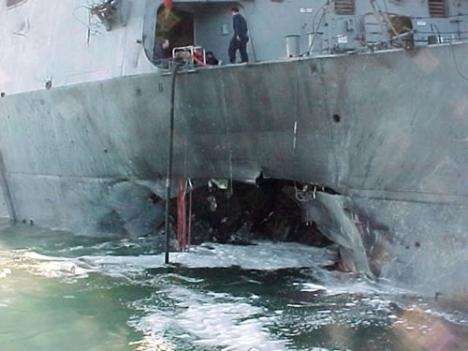 The damage caused to the USS Cole after the terrorist attack in October 2000 that killed 17 sailors.