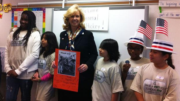 "Students at Mount Vernon Woods Elementary with General Allison Hickey for ""Take a Veteran to School Day."""
