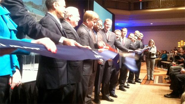 Virginia Gov. Bob McDonnell, third from left, cuts the ribbon for the 495 Express Lane.
