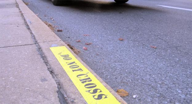 Pedestrian curb markers installed on Piney Branch Road near University Ave in Silver Spring, Md.